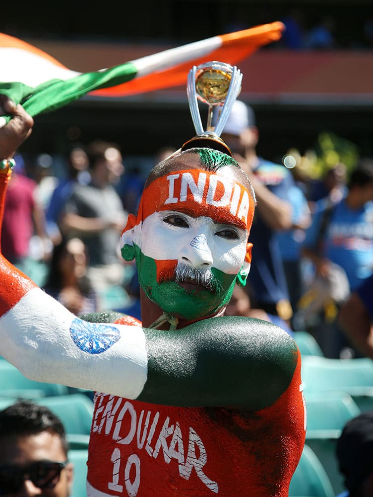 An Indian supporter waves a flag ahead of their Cricket World Cup semifinal against Australia in Sydney, Australia.