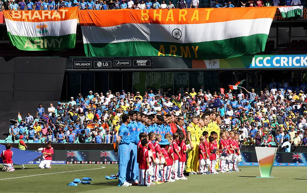 Indian and Australian teams line up for their national anthems ahead of their Cricket World Cup semifinal in Sydney, Australia.