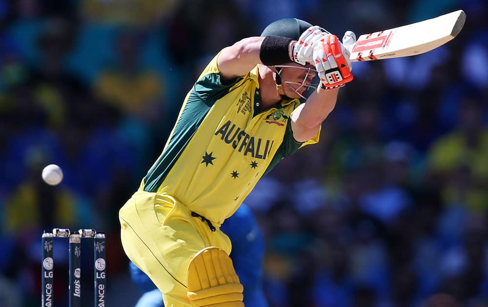 Australia's David Warner plays at the ball while batting against India during their Cricket World Cup semifinal in Sydney, Australia.