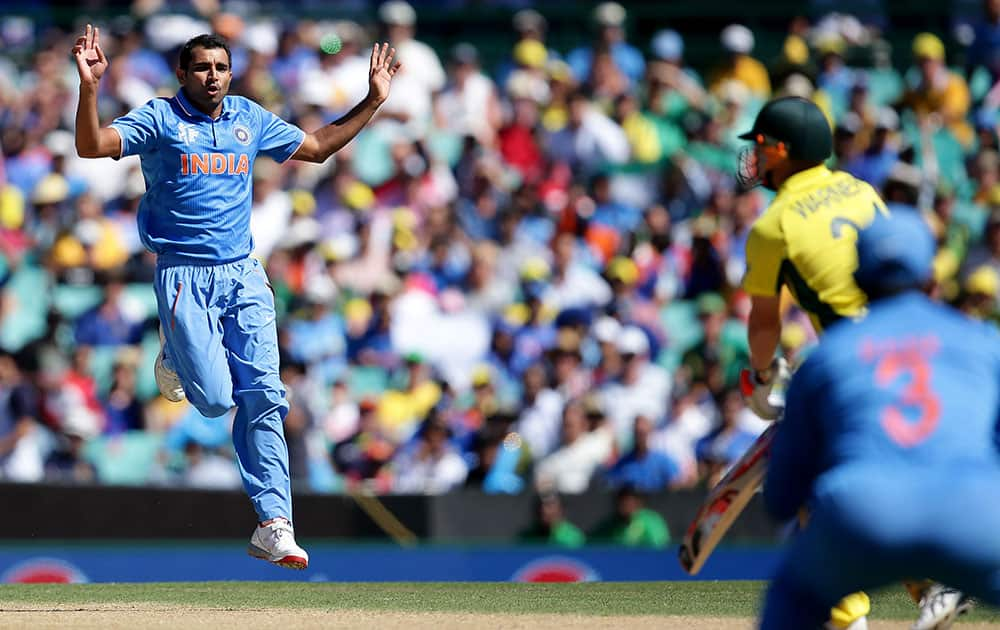 India's Mohammed Shami, left, reacts after bowling to Australia's Aaron Finch during their Cricket World Cup semifinal in Sydney, Australia.