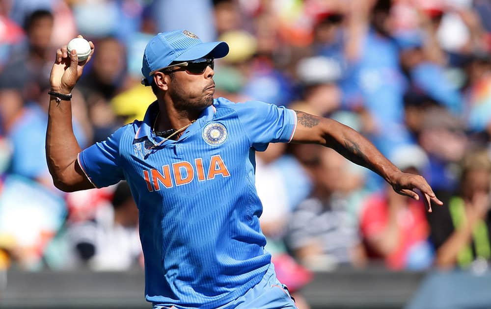 Umesh Yadav throws the ball back to a teammate during their Cricket World Cup semifinal against Australia in Sydney.