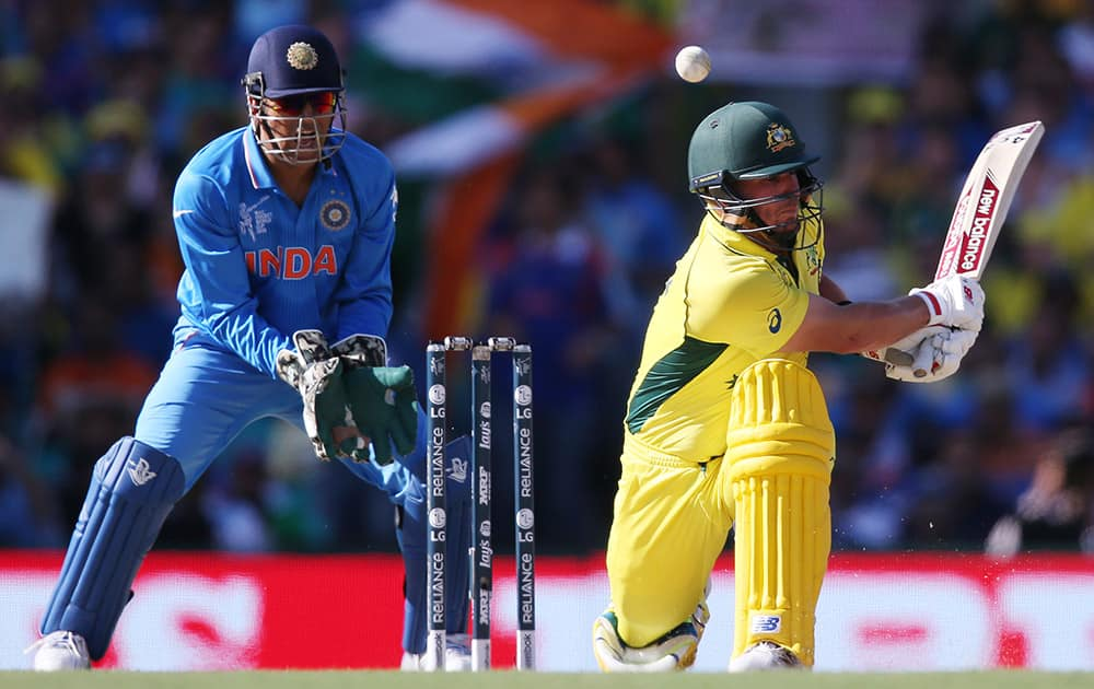 Australia's Aaron Finch plays and misses at the ball as India's MS Dhoni watches during their Cricket World Cup semifinal in Sydney.
