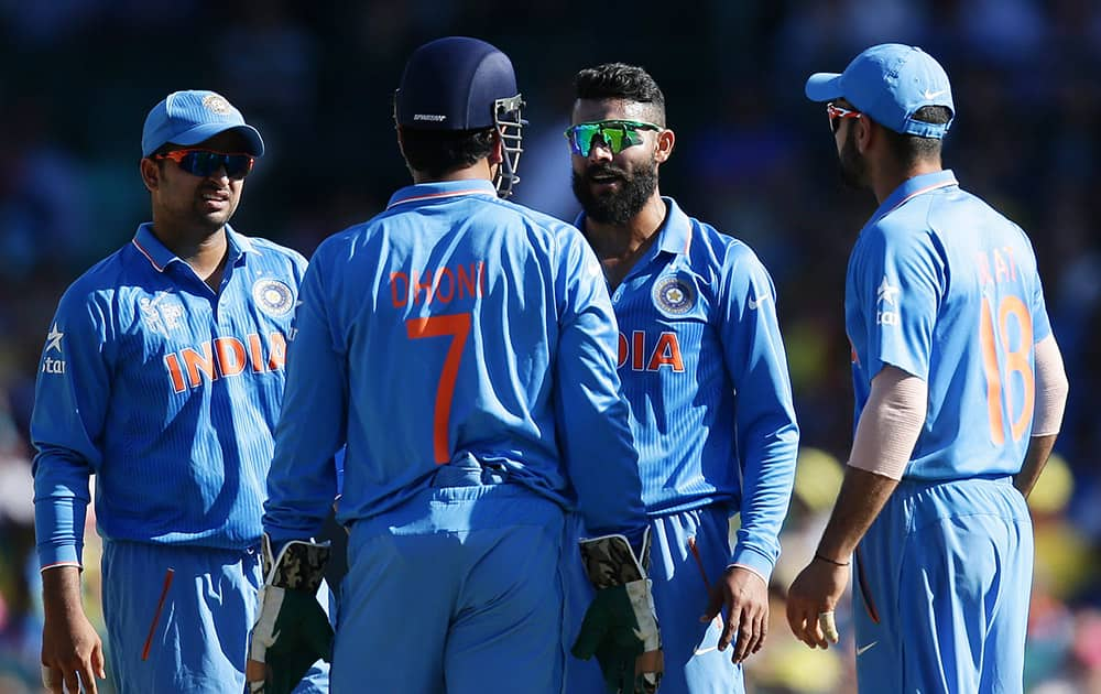 Ravindra Jadeja, talks with his captain India's MS Dhoni about calling for a video review of a LBW decision during their Cricket World Cup semifinal against Australia in Sydney, Australia.