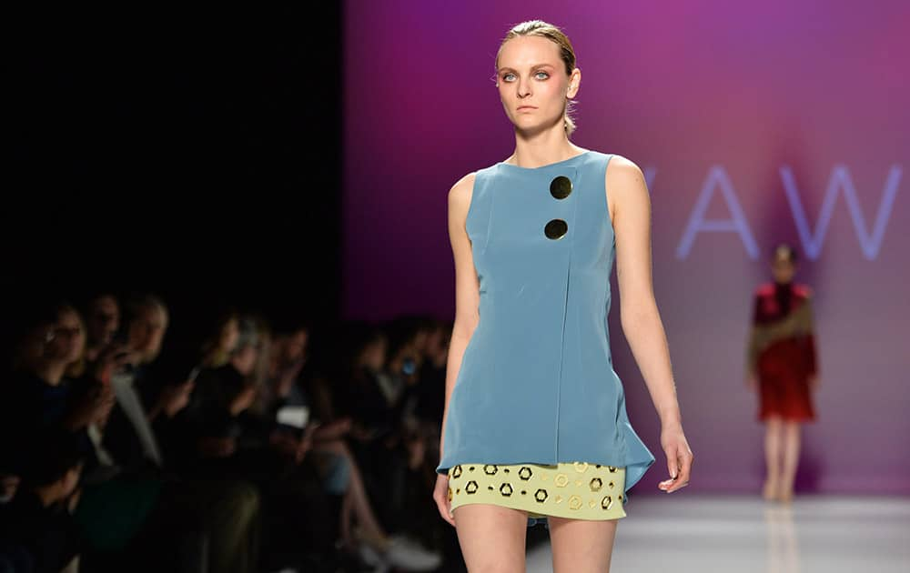 A model walks the runway for the VAWK Fall 2015 collection during Toronto fashion week in Toronto.