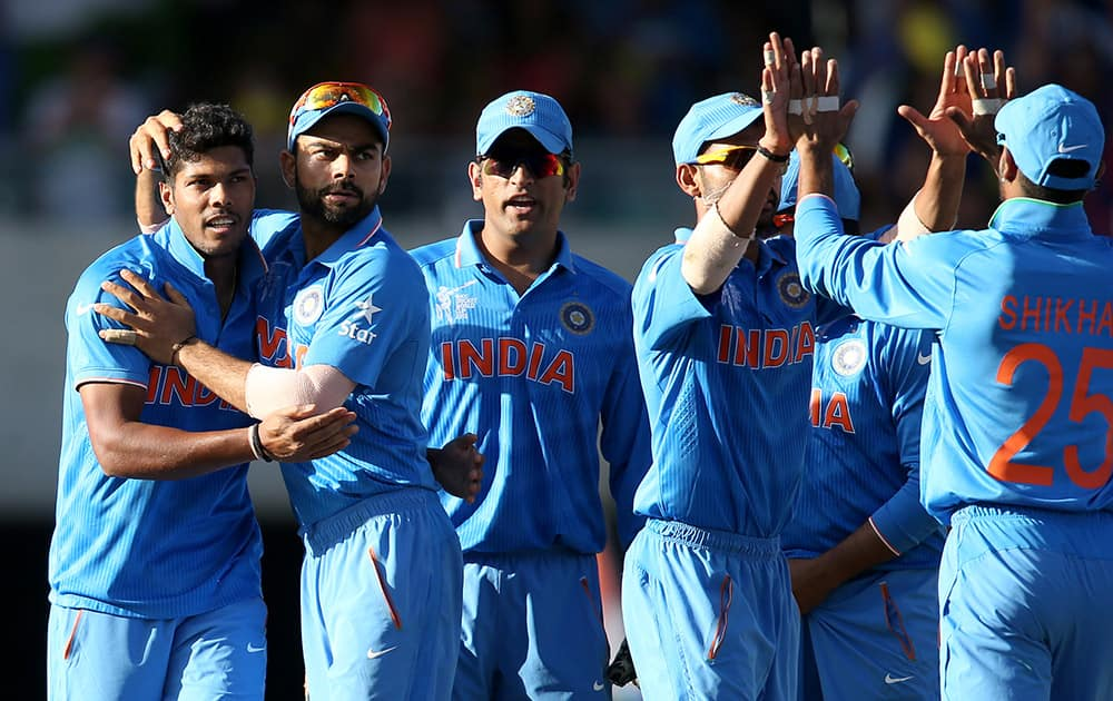 Players celebrate the dismissal of Australia's Aaron Finch during their Cricket World Cup semifinal in Sydney.