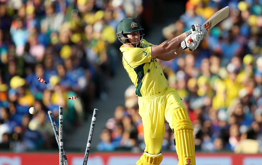 Australia's James Faulkner is bowled out for 21 runs during their Cricket World Cup semifinal against India in Sydney, Australia.
