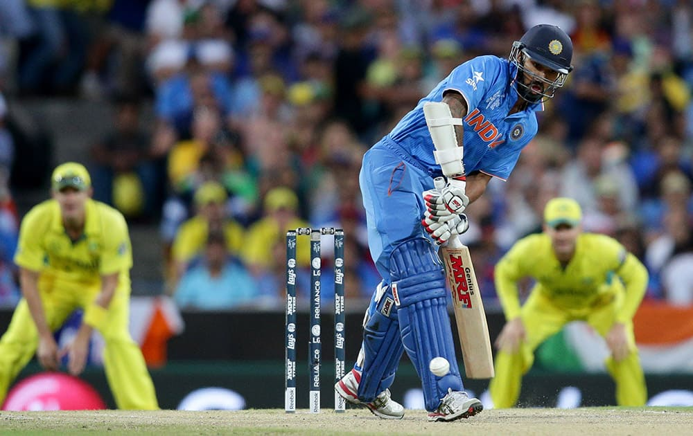 Shikhar Dhawan hits the ball while batting against Australia during their Cricket World Cup semifinal in Sydney.