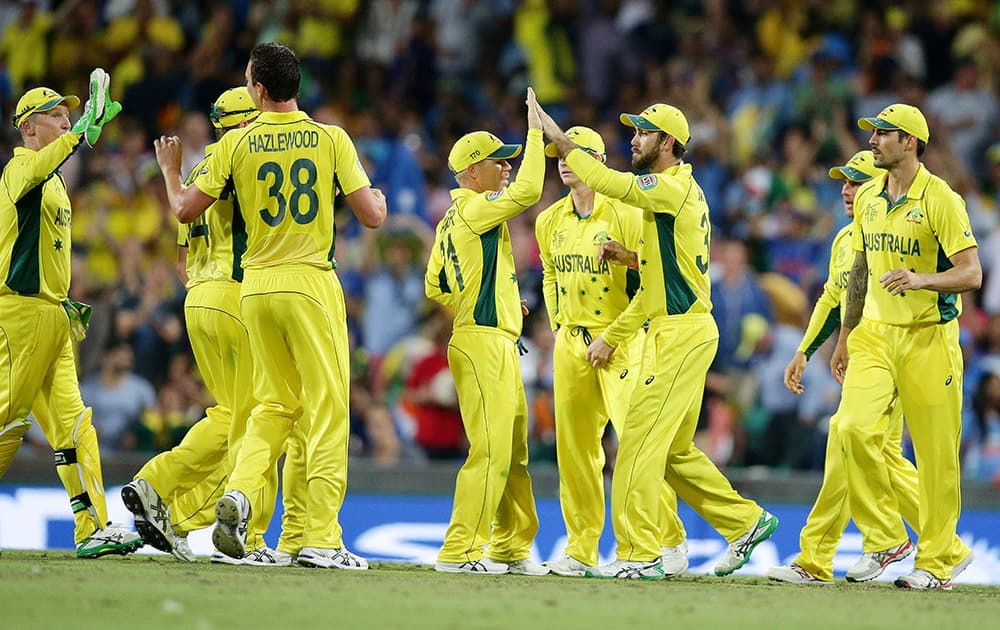 Australian players celebrate after taking the wicket of India's Shikhar Dhawan during their Cricket World Cup semifinal in Sydney.