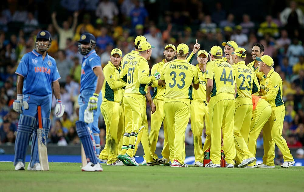 Australian players watch a video replay of the run out of India's Ravindra Jadeja during their Cricket World Cup semifinal in Sydney, Australia.