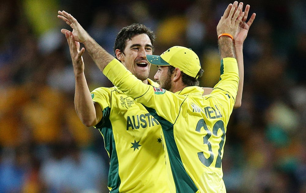 Australia's Glenn Maxwell is congratulated by teammate Mitchell Starc after running out India's MS Dhoni during their Cricket World Cup semifinal in Sydney, Australia.
