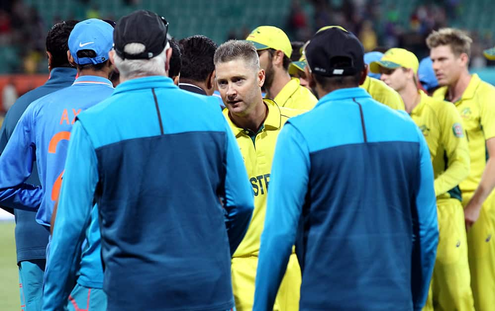 Australian captain Michael Clarke shakes hands with the Indian players after their 95 run win in their Cricket World Cup semifinal in Sydney, Australia.