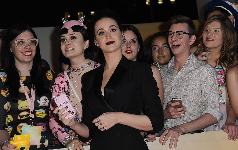 Katy Perry, poses with fans at the World Premiere Of 'Katy Perry: The Prismatic World Tour' held at The Theatre at Ace Hotel, in Los Angeles.