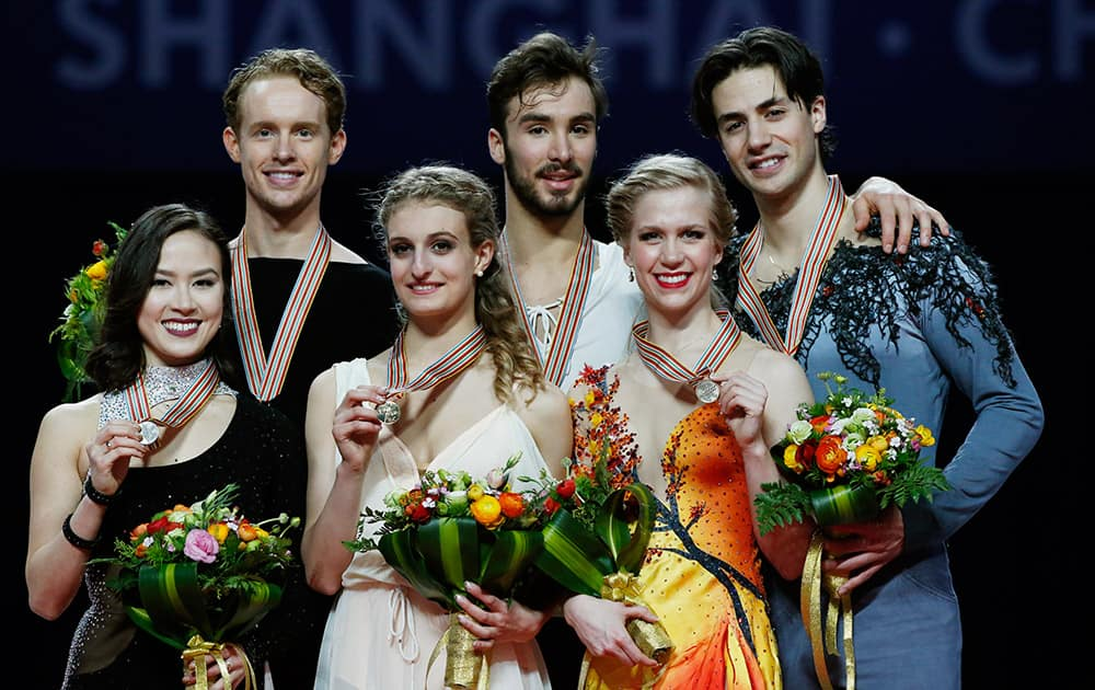 Posing with their medals for the Ice Dance Free Dance event; Gabriella Papadakis and Guillaume Cizeron of France with gold, Madison Chock and Evan Bates of the United States, with silver and Kaitlyn Weaver and Andrew Poje of Canada with bronze in the ISU World Figure Skating Championship 2015 held at the Oriental Sports Center in Shanghai, China.