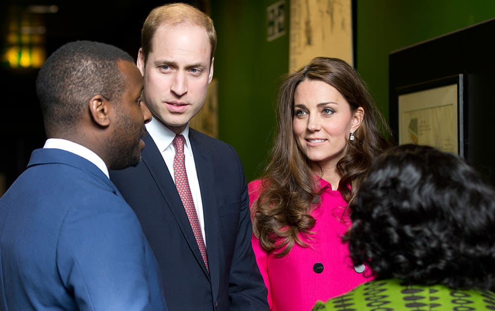 Britain's Prince William and Kate Duchess of Cambridge speak with Stephen Lawrence's brother Stuart and his mother Baroness Doreen Lawrence at the Stephen Lawrence Centre London. Stephen Lawrence was stabbed to death by a group of white youths in April 1993, he was 19 years old and waiting for a bus, the centre is built in his memory.