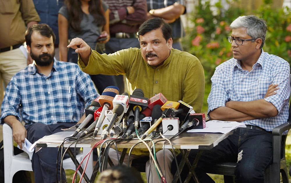 AAP leaders Sanjay Singh, Ashish Khetan and Ashutosh during a press conference in New Delhi.