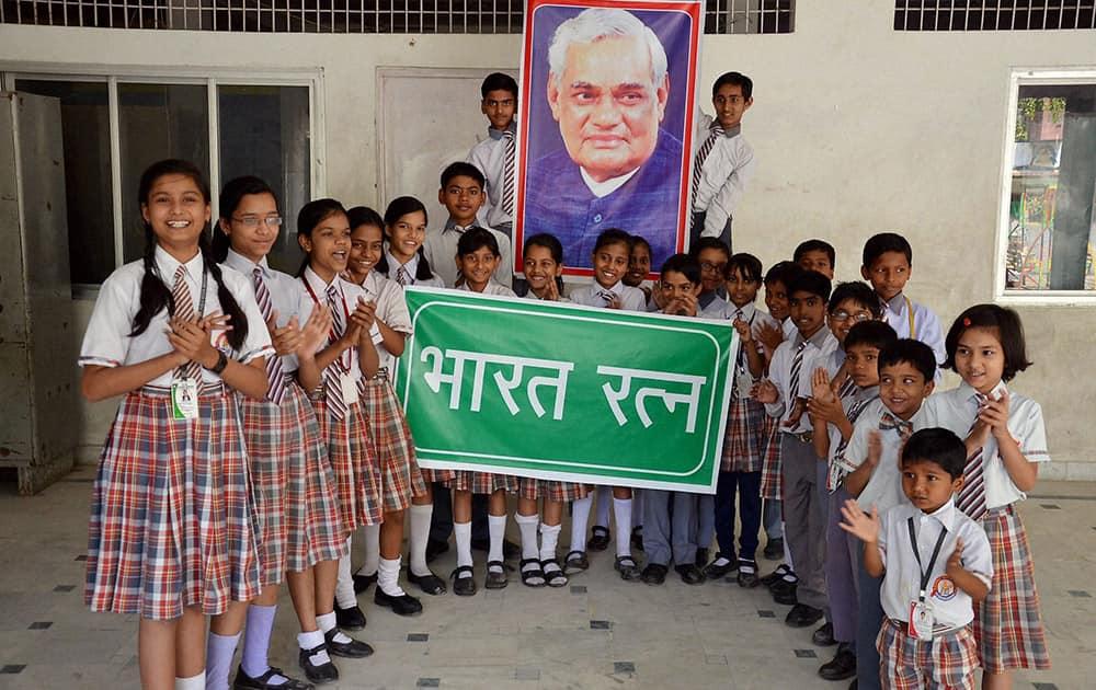 School students congratulate Bharat Ratna winner and former Prime Minister Atal Bihari Vajpayee, in Mirzapur.