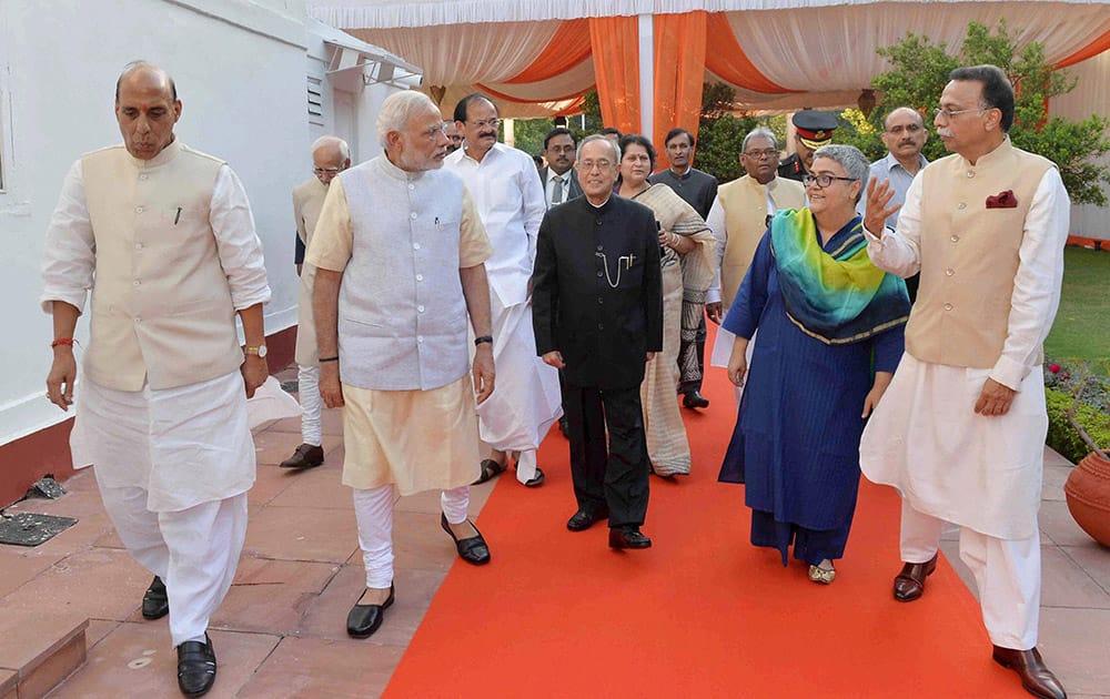 President Pranab Mukherjee arrives to confer the Bharat Ratna on former Prime Minister Atal Bihari Vajpayee at his residence in New Delhi.