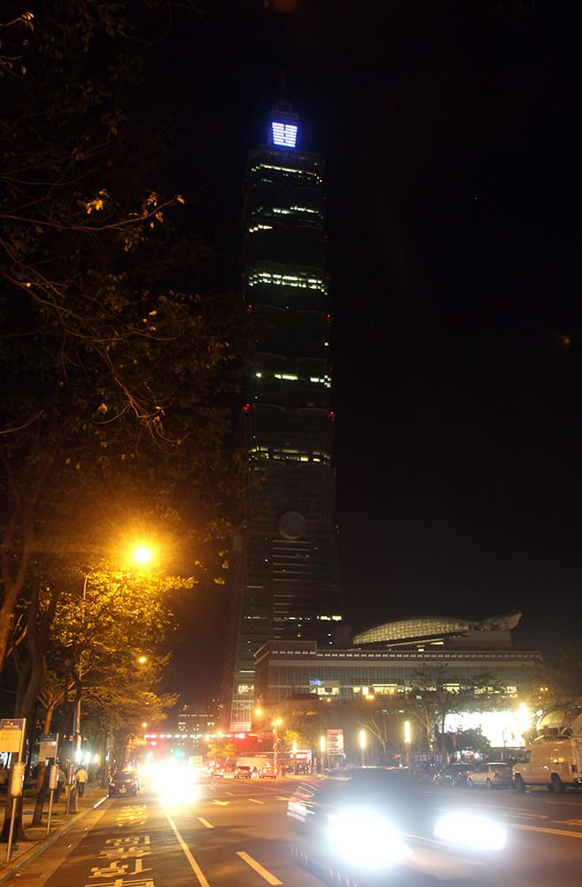 The Taipei 101 Building is seen darkened during the Earth Hour in Taipei, Taiwan. Organised by the World Wide Fund for Nature, Earth Hour is observed every year to create awareness about conservation of energy and climate change. Around the world, people and organisations will be turning their lights off from 8:30 to 9:30 pm local time.