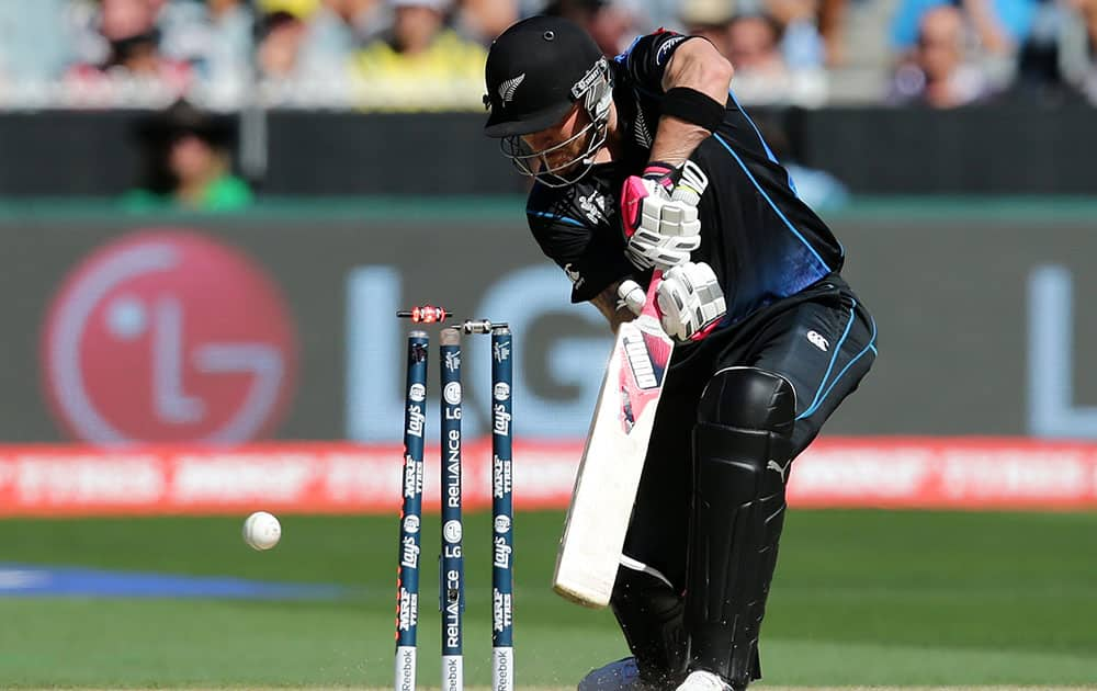 New Zealand captain Brendon McCullum is bowled for no score by Australia's Mitchell Starc during the Cricket World Cup final in Melbourne, Australia.