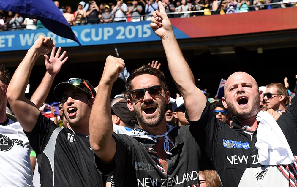 New Zealand fans cheer on their team during the Cricket World Cup final against Australia in Melbourne, Australia.
