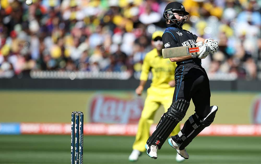 New Zealand's Kane Williamson avoids a bouncer while batting against Australia during the Cricket World Cup final in Melbourne, Australia.
