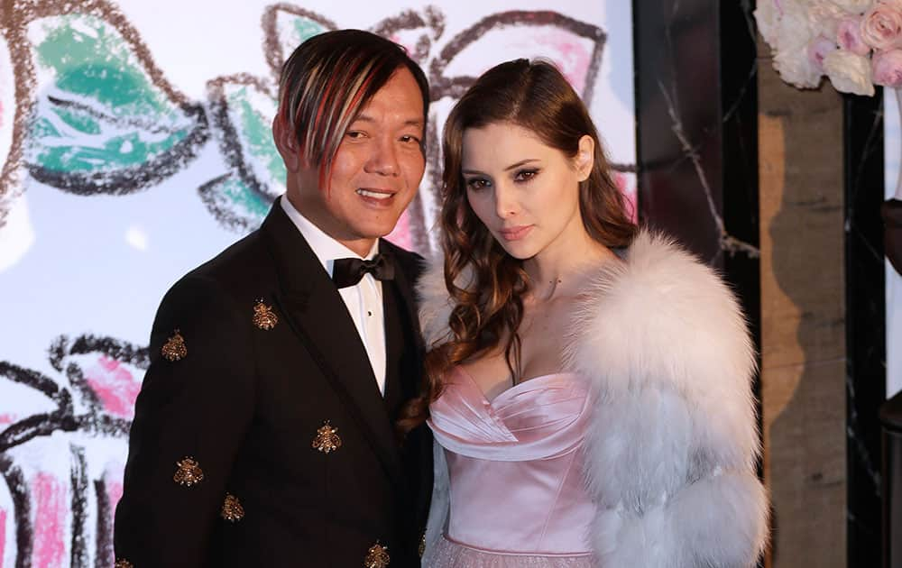Chinese businessman Stephen Hung and his wife Deborah pose for photographers as they arrive at the Rose Ball in Monaco. The Rose Ball is the traditional annual charity event in the Principality of Monaco.