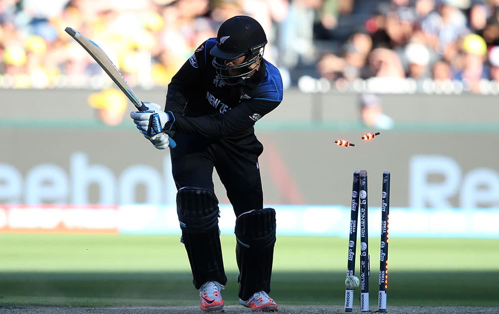 New Zealand's Dan Vettori is bowled out for nine runs while batting against Australia during the Cricket World Cup final in Melbourne, Australia.