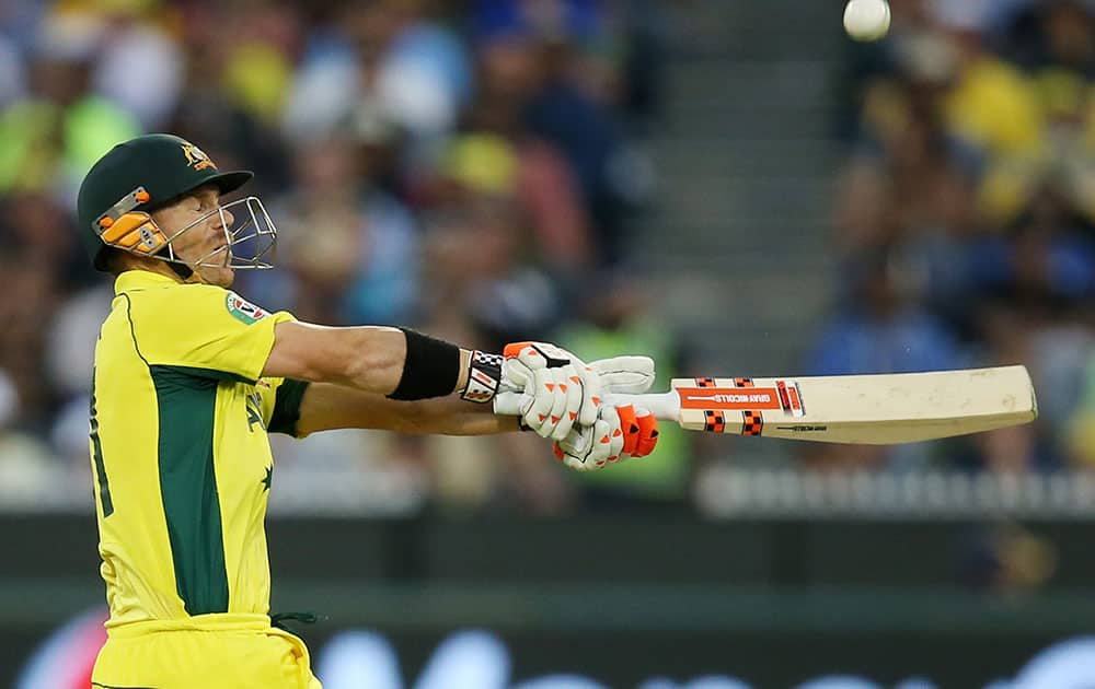 Australia's David Warner hits the ball to the boundary while batting against New Zealand during the Cricket World Cup final in Melbourne, Australia.