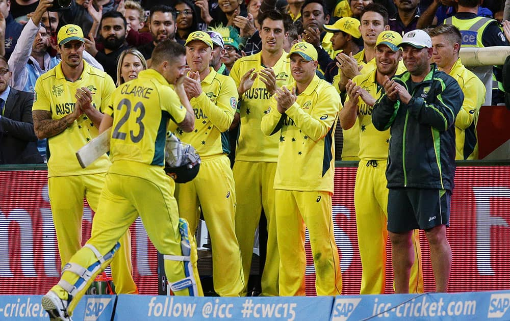 Members of the Australian team clap their captain Australian captain Michael Clarke from the field after his innings of 74 runs while batting against New Zealand during the Cricket World Cup final in Melbourne, Australia.