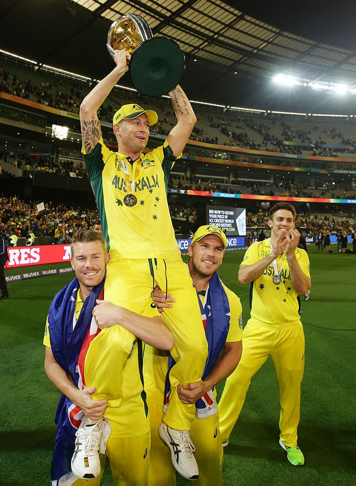 Australian captain Michael Clarke is held aloft by teammates as he celebrates their seven wicket victory over New Zealand to win the Cricket World Cup final in Melbourne, Australia.