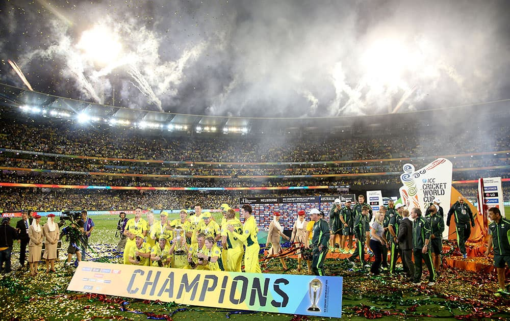 Fireworks explode around the Melbourne Cricket Ground as the Australian team celebrate their seven wicket win over New Zealand in the Cricket World Cup final in Melbourne, Australia.