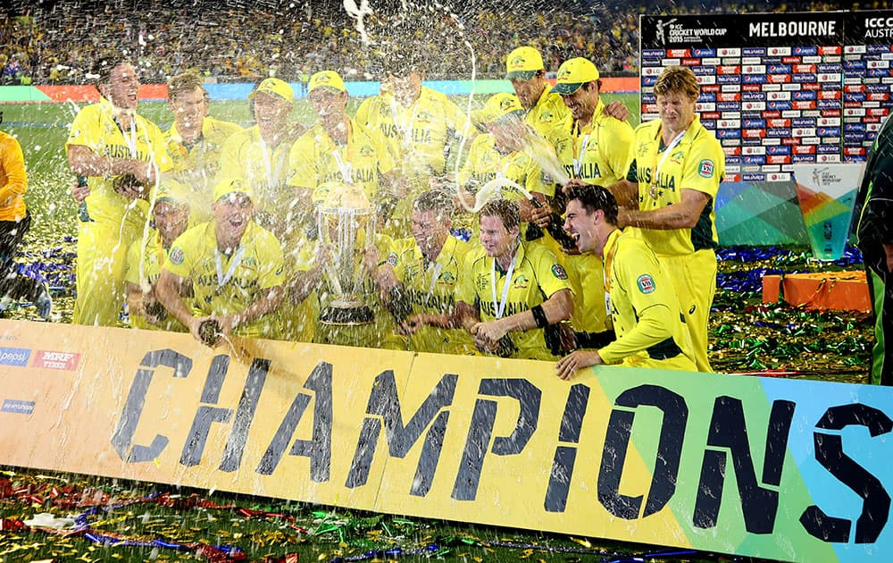 The Australian team spray champagne as they celebrate their seven wicket win over New Zealand in the Cricket World Cup final in Melbourne, Australia.