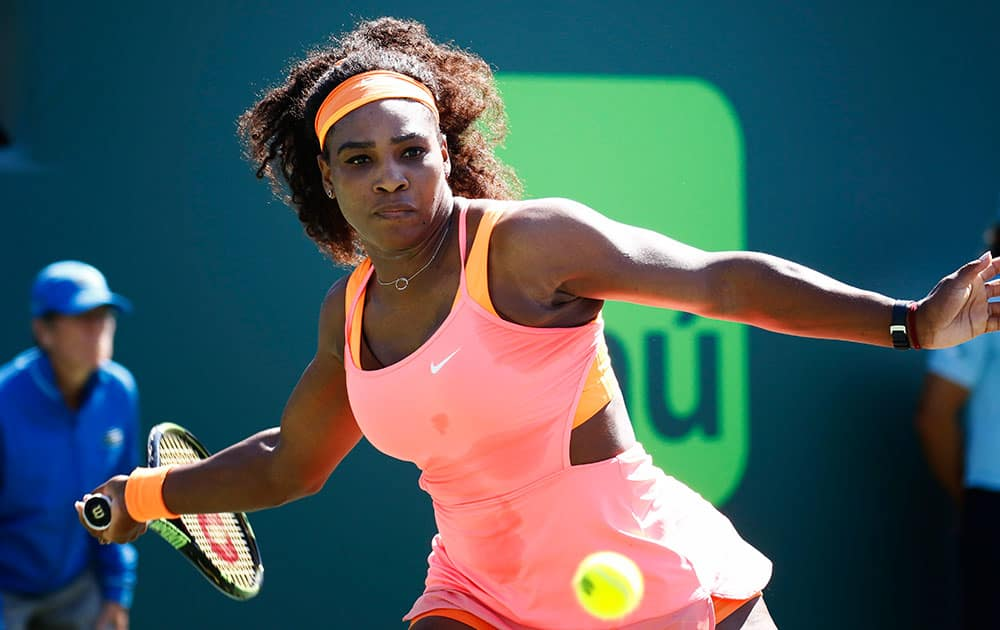 Serena Williams returns the ball to CiCi Bellis at the Miami Open tennis tournament in Key Biscayne, Fla.