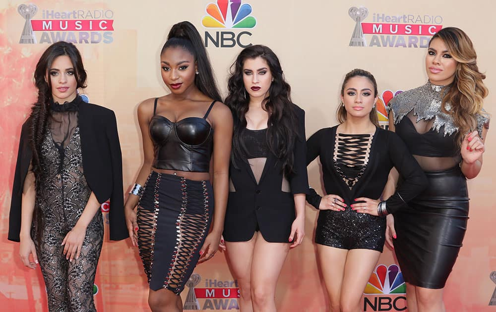 Camila Cabello, from left, Normani Kordei, Lauren Jauregui, Ally Brooke Hernandez and Dinah Jane Hansen, of Fifth Harmony, arrive at the iHeartRadio Music Awards at The Shrine Auditorium, in Los Angeles.