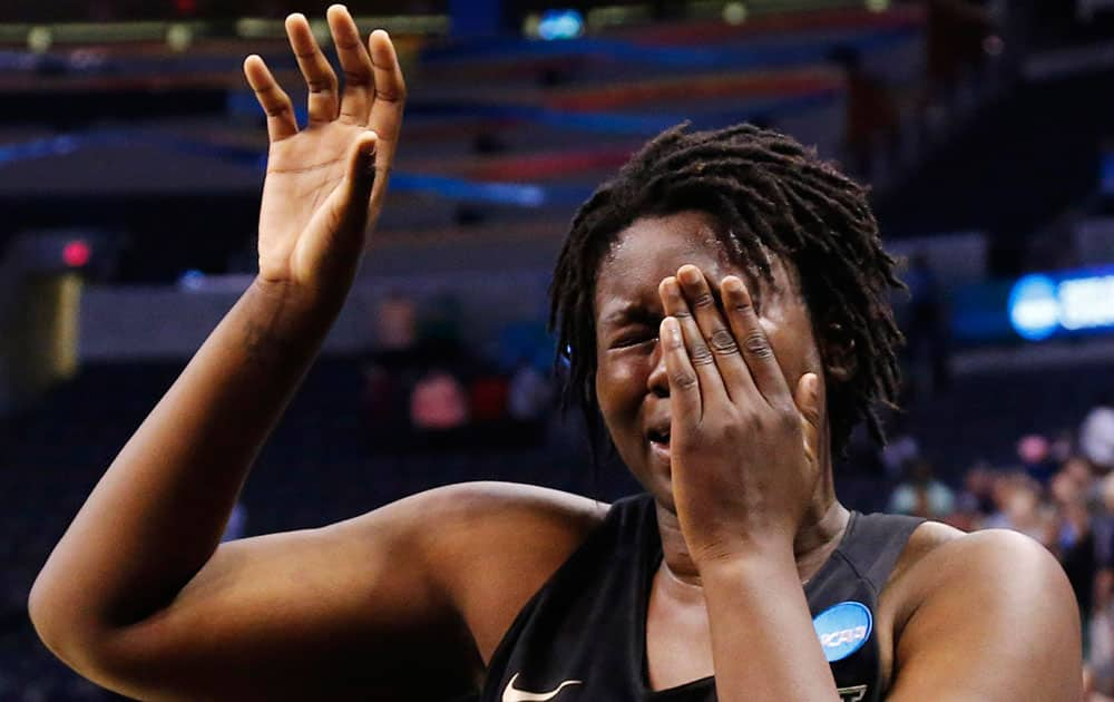 Baylor forward Sune Agbuke cries after Baylor's 77-68 loss to Notre Dame during a regional final in the NCAA women's college basketball tournament, in Oklahoma City.