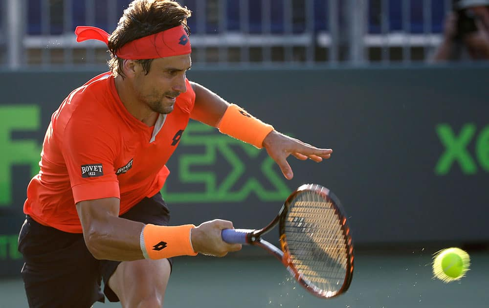David Ferrer, of Spain, returns to Lukas Rosol at the Miami Open tennis tournament, in Key Biscayne, Fla. Ferrer won the match 6-4, 7-5.