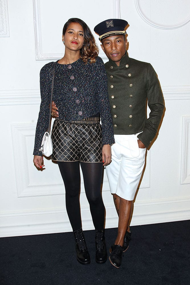 Helen Lasichanh, left, and Pharrell Williams arrive at the Chanel Paris-Salzburg 2014/15 Metiers d'Art Collection fashion show at the Park Avenue Armory in New York.