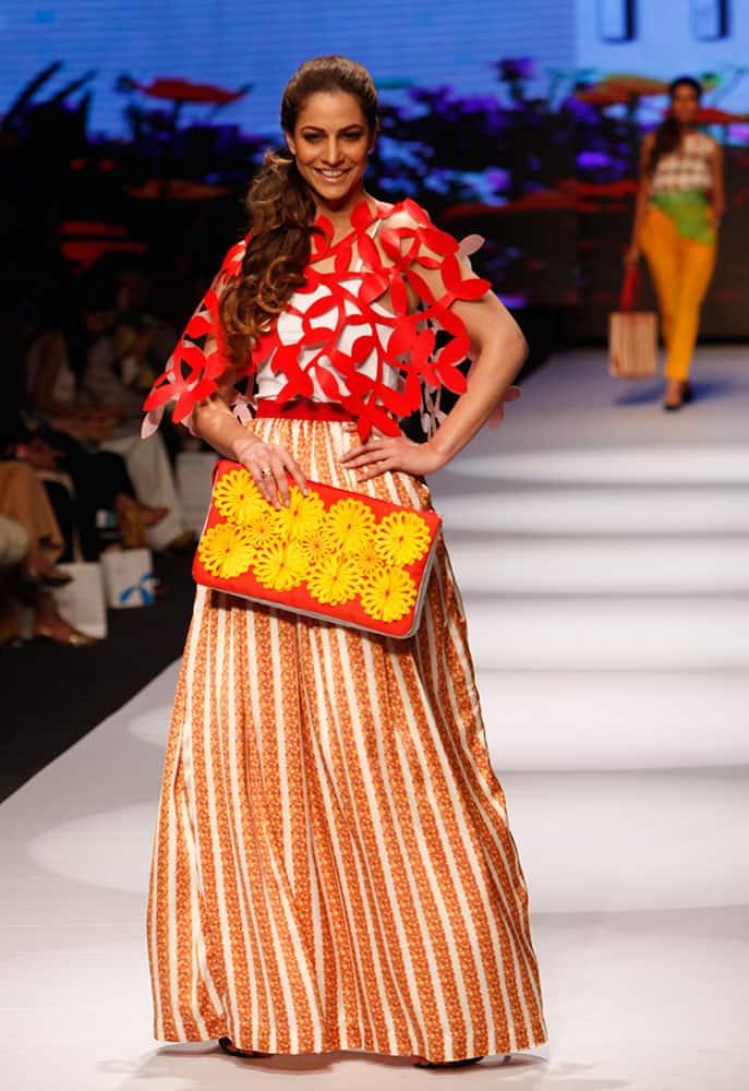 Models present creations by Pakistani designer Madiha Raza at Fashion Pakistan Week 2015.
