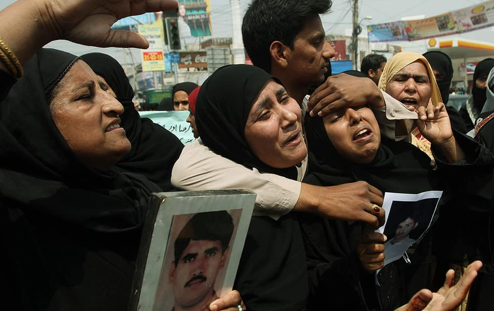 Family members of stranded Pakistanis in Yemen protest to demand their return, as they gather in Multan, Pakistan.