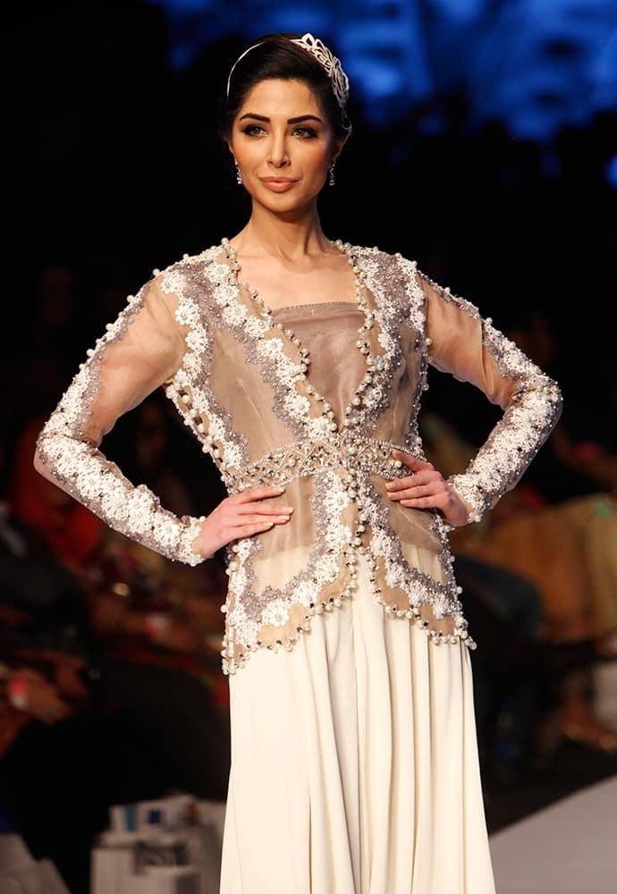 A model presents creations by Pakistani designer Nida Azwer at Fashion Pakistan Week 2015, in Karachi, Pakistan.