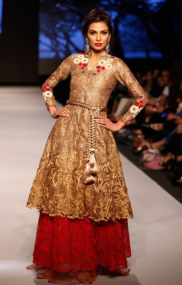 A model presents creations by Pakistani designer Sanam Chaudhri at Pakistan Fashion Week 2015, in Karachi, Pakistan.