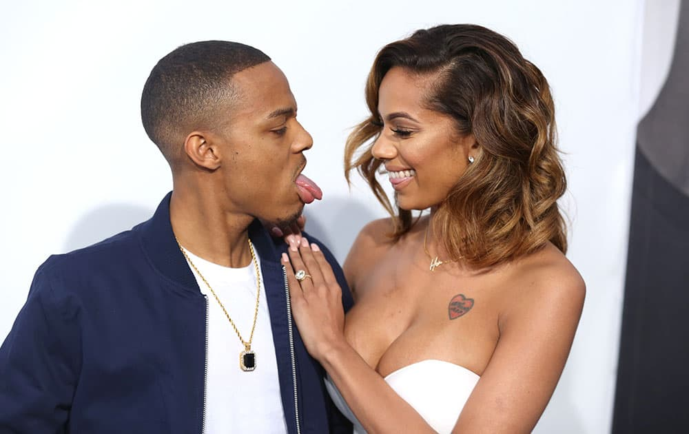 Shad Moss, left, and Erica Mena arrive at the premiere of