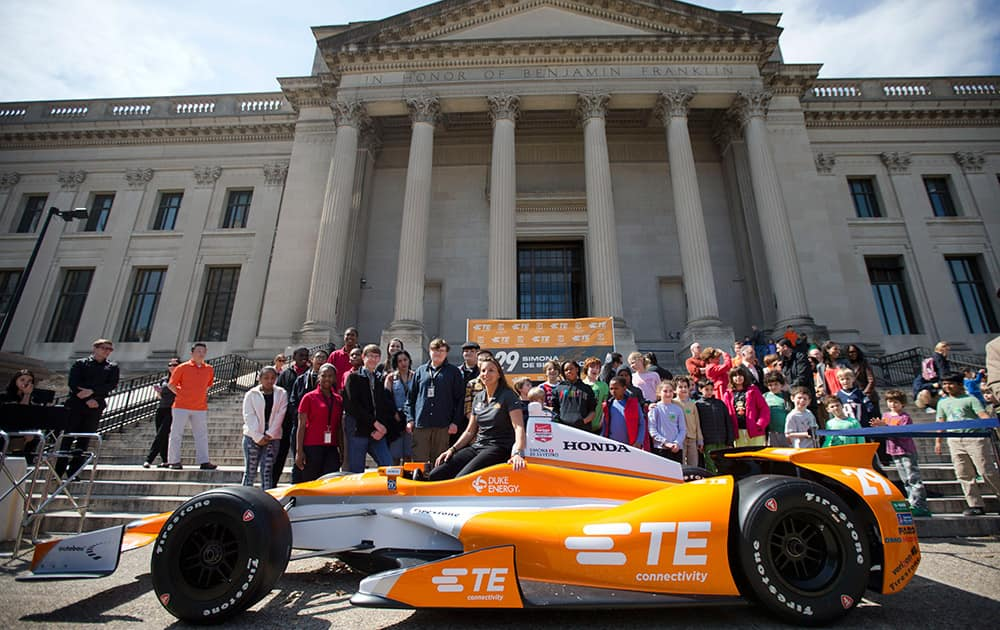 Driver Simona de Silvestro poses for photographs during a news conference, at the The Franklin Institute in Philadelphia.