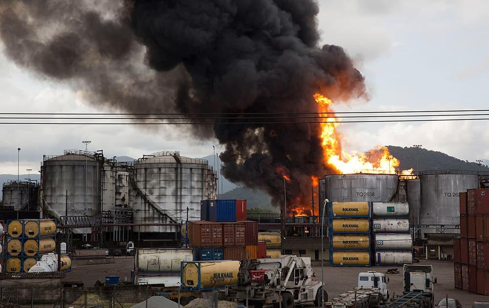 Smoke rises from a fire at a liquid bulk storage facility near Brazil's port of Santos.