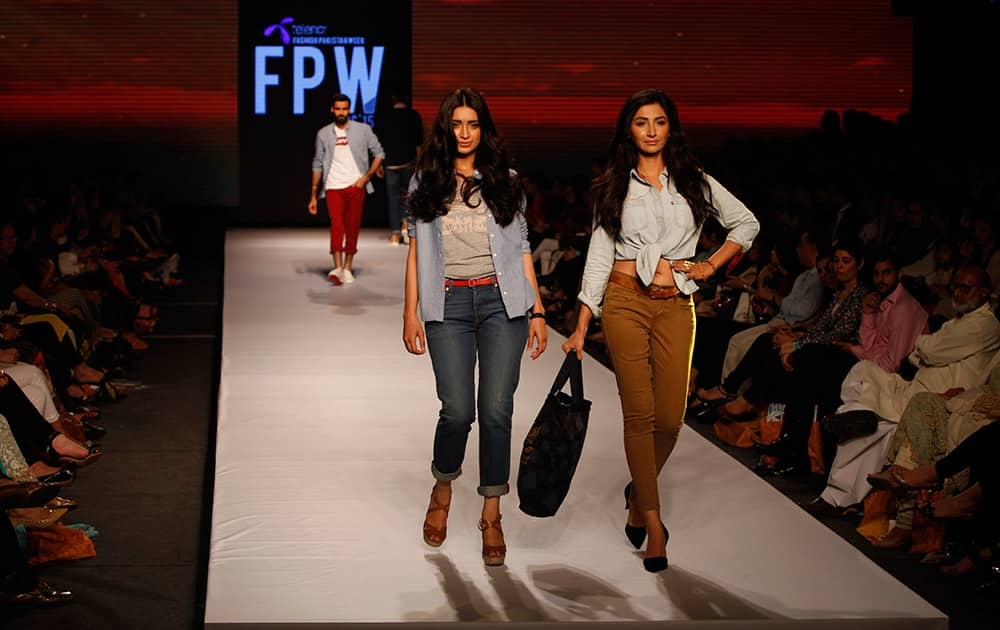 Models present creations by International label Levi's at Fashion Pakistan Week, Pakistan.