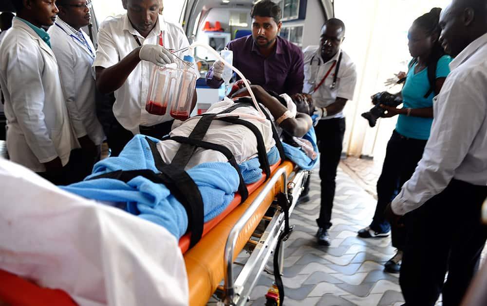 Medics help an injured person at Kenyatta national Hospital in Nairobi, Kenya.