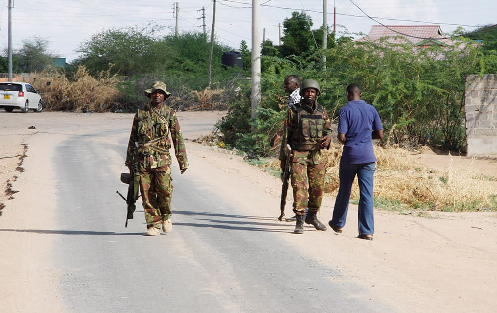 Members of Kenya's Defence Forces secure the area of the Garissa University college, in Garissa, Kenya. Witnesses say the gunmen who stormed a college in Kenya this morning identified themselves as members of al-Shabab, the Islamic extremist group from neighboring Somalia.