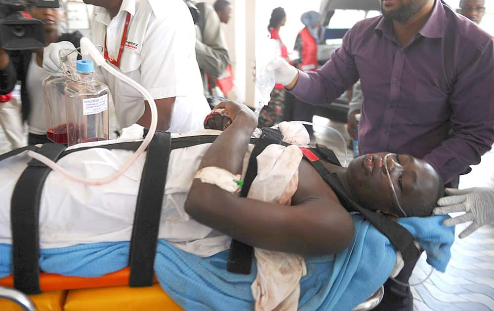 Medics help an injured person at Kenyatta national Hospital in Nairobi, Kenya, after being airlifted from Garissa after an attack by gunmen at Garissa University College in northeastern Kenya on Thursday morning. Al-Shabab gunmen attacked Garissa University College in northeast Kenya early Thursday, targeting Christians and killing at least 15 people and wounding 60 others, witnesses said.