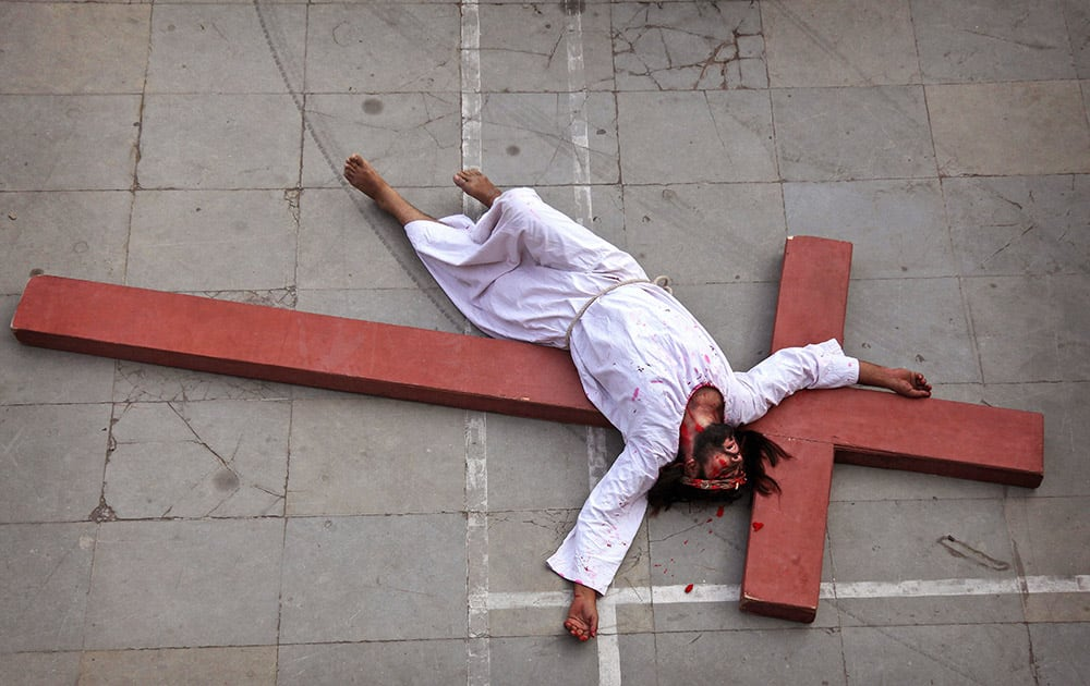 An Indian Christian devotee enacts the crucifixion of Jesus Christ to mark Good Friday at Sacred Heart Church in Hyderabad.