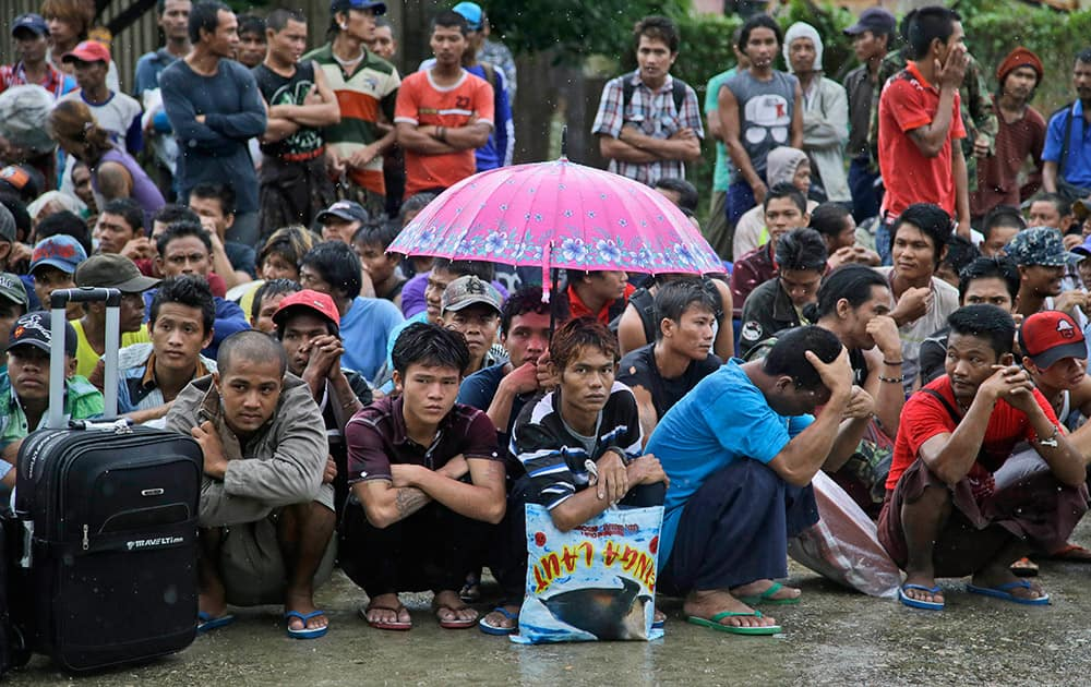 Burmese fishermen wait for their departure to leave the compound of Pusaka Benjina Resources fishing company in Benjina, Aru Islands, Indonesia.